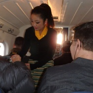 Teeny, tiny plane still had a flight attendent. She passed out candy to suck on and cotton for ears